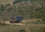 We get to the top, and see a truck carrying parts for an oil rig up a different road.
